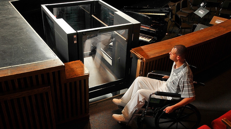 Ascension Protege Wheelchair Lift being approached by college student