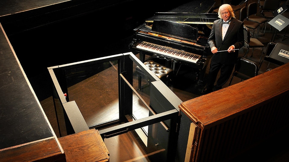 Ascension Protege Wheelchair Lift next to a symphony conductor