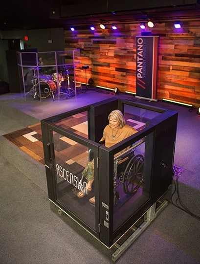 Ascension Protege Wheelchair Lift being used by a teacher for stage use