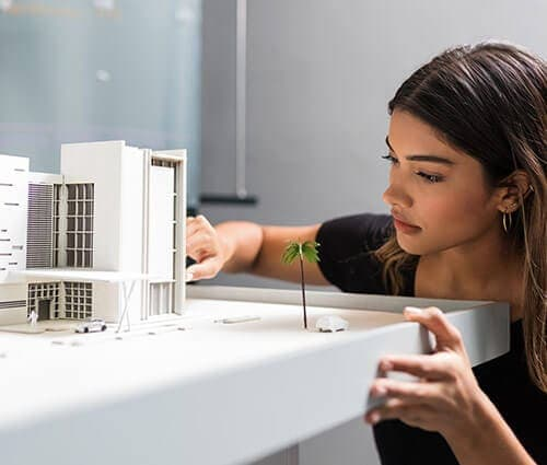 Architect Studying Building Layout Scale Model